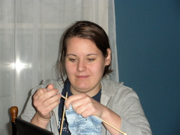 Claire learning to knit (she doesn't usually make this face, but I couldn't get a better picture)