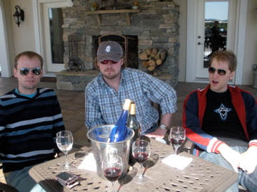 The boys, sitting in the shade, wearing sunglasses